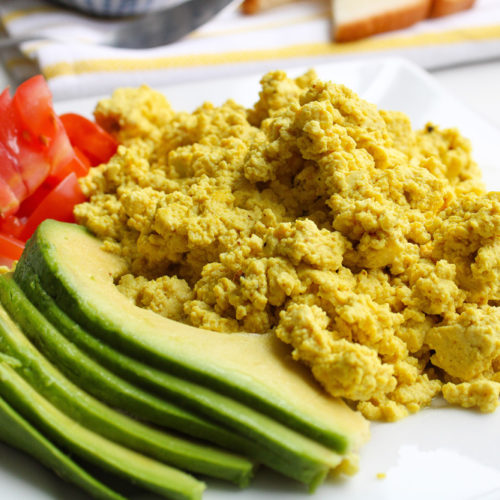 Tofu Scramble with tomatoes and avocado on a plate